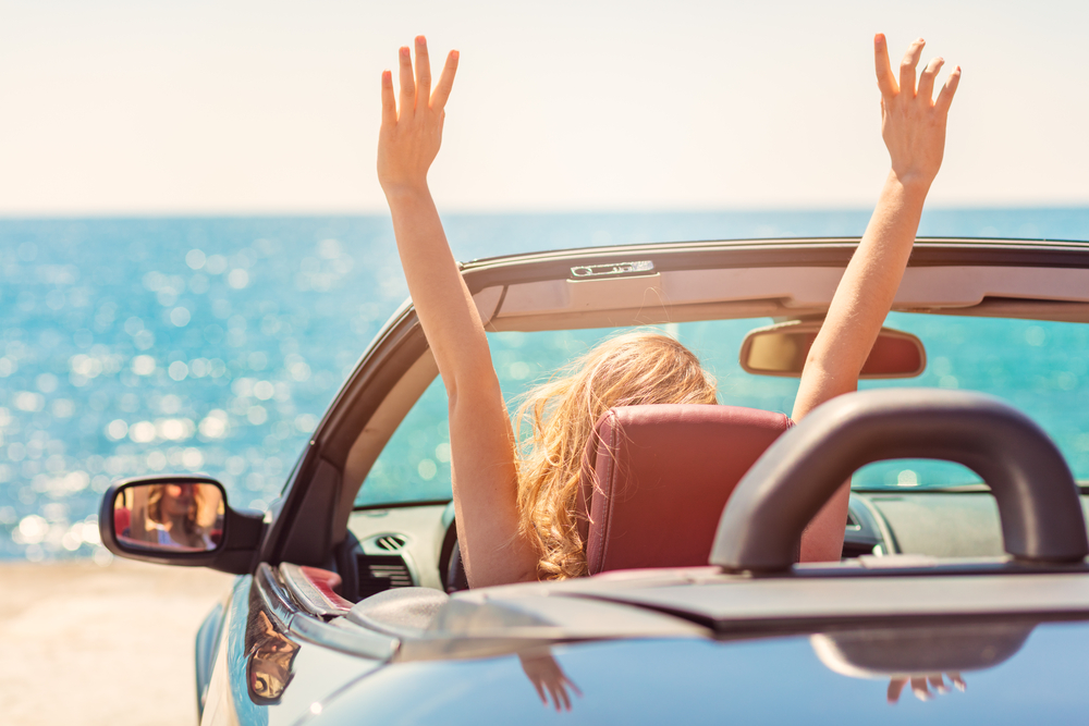 Girl Driving With Roof Down On Beach